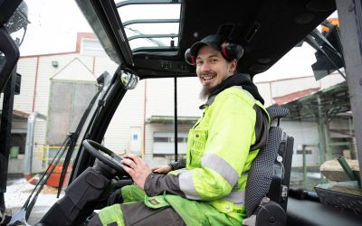 A rocker behind the wheel of a forklift